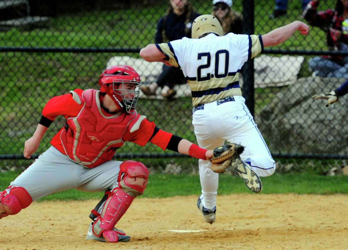 ND-Fairfield's Brandon White beats the tag by Stratford catcher Jonathan Brooks to score a run during Friday's game in Fairfield. ND-Fairfield posted a 9-6 victory in the SWC contest.