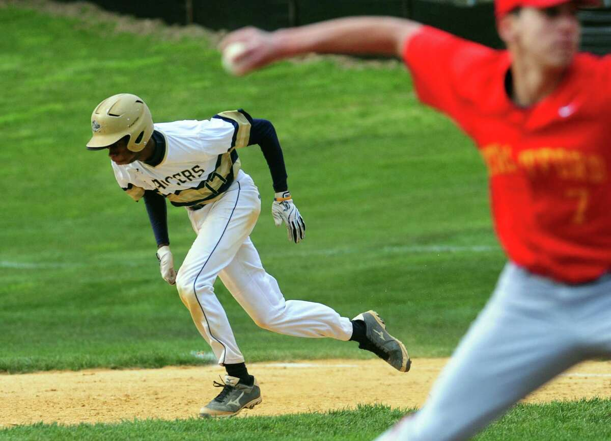 Notre Dame of Fairfield's Garnell Bell takes off for second in a steal during baseball action against Stratford in Fairfield, Conn., on Friday Apr. 29, 2016.