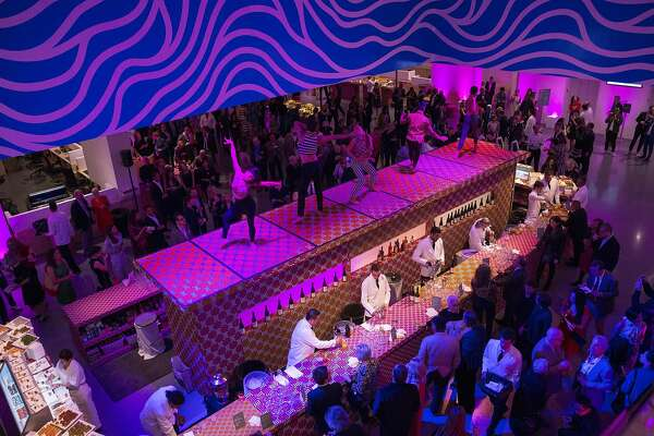 Dancers perform on top of the bar for guests of Art Bash, a party to celebrate the reopening of the San Francisco Museum of Modern Art after it�s renovation and expansion, during the event at the museum in San Francisco, Calif., on Friday, April 29, 2016. The museum opens to the public on May 14.