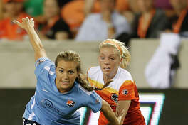 Sky Blue FC midfielder Kelly Conheeney (24) battles against Houston Dash Denise O'Sullivan (13) during the second half of a National Women's Soccer League game at BBVA Compass Stadium, Friday, April 29, 2016, in Houston.