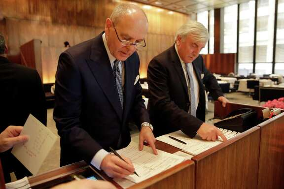 Four Seasons restaurant co-owners Alex von Bidder, left, and Julian Niccolini look over the luncheon reservations lists at the restaurant in New York, Friday, April 29, 2016. New York's original power lunch restaurant is closing and everything must go. The July 26 auction was announced this week and will mark the end of an era for a restaurant that has been a favorite of celebrities and business titans ever since it opened in 1959. (AP Photo/Richard Drew)
