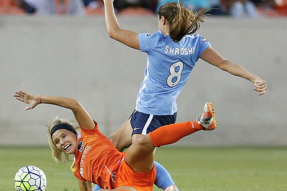 Dash forward Rachel Daly battles Sky Blue FC defender Erica Skroski (8) for control of the ball in the first half of Friday's game at BBVA Compass Stadium.