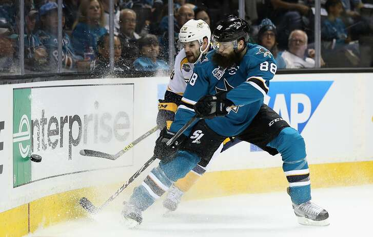 SAN JOSE, CA - APRIL 29:  Brent Burns #88 of the San Jose Sharks and Paul Gaustad #28 of the Nashville Predators go for the puck in Game One of the Western Conference Second Round during the 2016 NHL Stanley Cup Playoffs at SAP Center on April 29, 2016 in San Jose, California.  (Photo by Ezra Shaw/Getty Images)