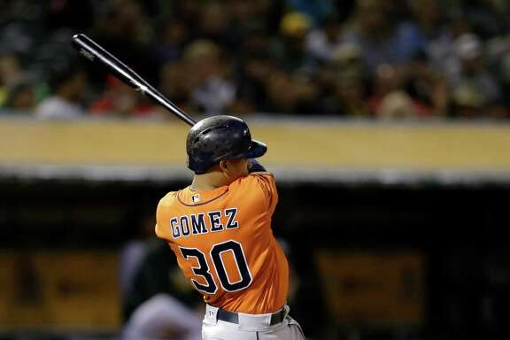 Houston Astros' Carlos Gomez swings for an RBI ground rule double off Oakland Athletics' Sean Doolittle in the sixth inning of a baseball game Friday, April 29, 2016, in Oakland, Calif. (AP Photo/Ben Margot)
