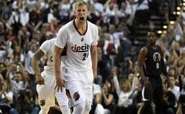 *** BESTPIX *** PORTLAND, OR - APRIL 29: Mason Plumlee #24 of the Portland Trail Blazers celebrates after his teammate scores in the first quarter of Game Six of the Western Conference Quarterfinals against the Los Angeles Clippers during the 2016 NBA Playoffs at the Moda Center on April 29, 2016 in Portland, Oregon. NOTE TO USER: User expressly acknowledges and agrees that by downloading and/or using this photograph, user is consenting to the terms and conditions of the Getty Images License Agreement. (Photo by Steve Dykes/Getty Images)