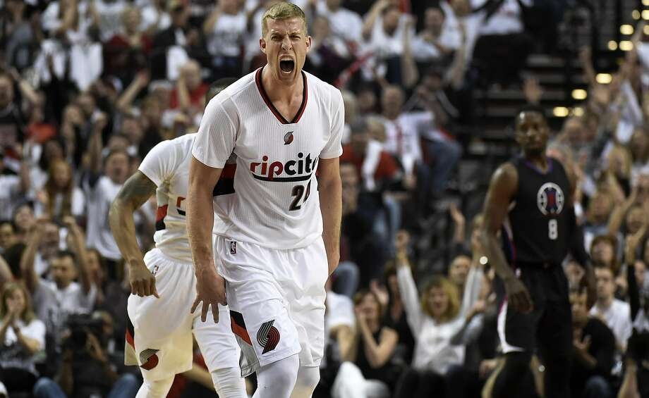 Trail Blazers center Mason Plumlee celebrates after his team scored on their way to beating the Clippers 106-103 in Portland. Photo: Steve Dykes
