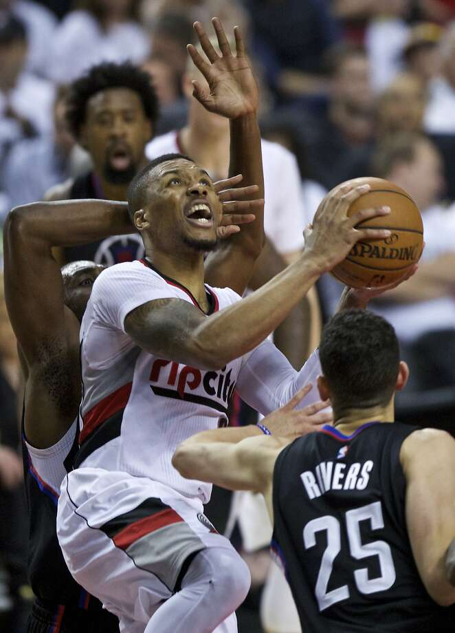 Damian Lillard scored 28 points to lead the Trail Blazers into the next round against the Warriors. Photo: Craig Mitchelldyer, Associated Press