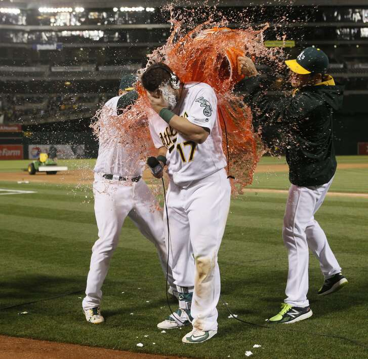 Oakland Athletics' Yonder Alonso gets a pie to the face and Gatorade shower after he hit a walk-off three-run homerun to defeat the Houston Astros on Friday, April 29, 2016 in Oakland, Calif.