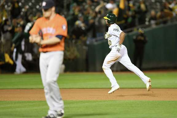 OAKLAND, CA - APRIL 29:  Marcus Semien #10 of the Oakland Athletics trots around the bases after hitting a solo home run off of Ken Giles #53 of the Houston Astros in the bottom of the eighth inning at the Coliseum on April 29, 2016 in Oakland, California.