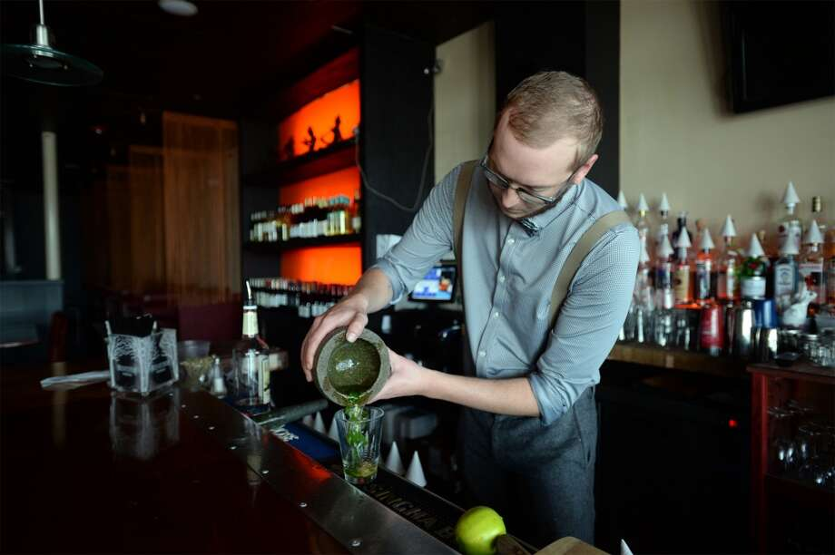 Caleb Lewis shows a Mojito at Chaba on Phelan Friday. Photo taken Friday, April 22, 2016 Guiseppe Barranco/The Enterprise Photo: Guiseppe Barranco/The Enterprise