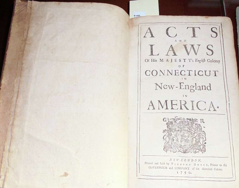 """The newly acquired Collier Collection at the Fairfield Museum and History Center's Research Library is one of the most comprehensive collections of Connecticut history, and includes about 2,000 volumes, some dating to the mid-18th Century. This book, """"Acts and Laws of His Majesty's English Colony of Connecticut in New England in America,"""" was published in 1750. Photo: Meg Barone / For Hearst Connecticut Media / Fairfield Citizen"""