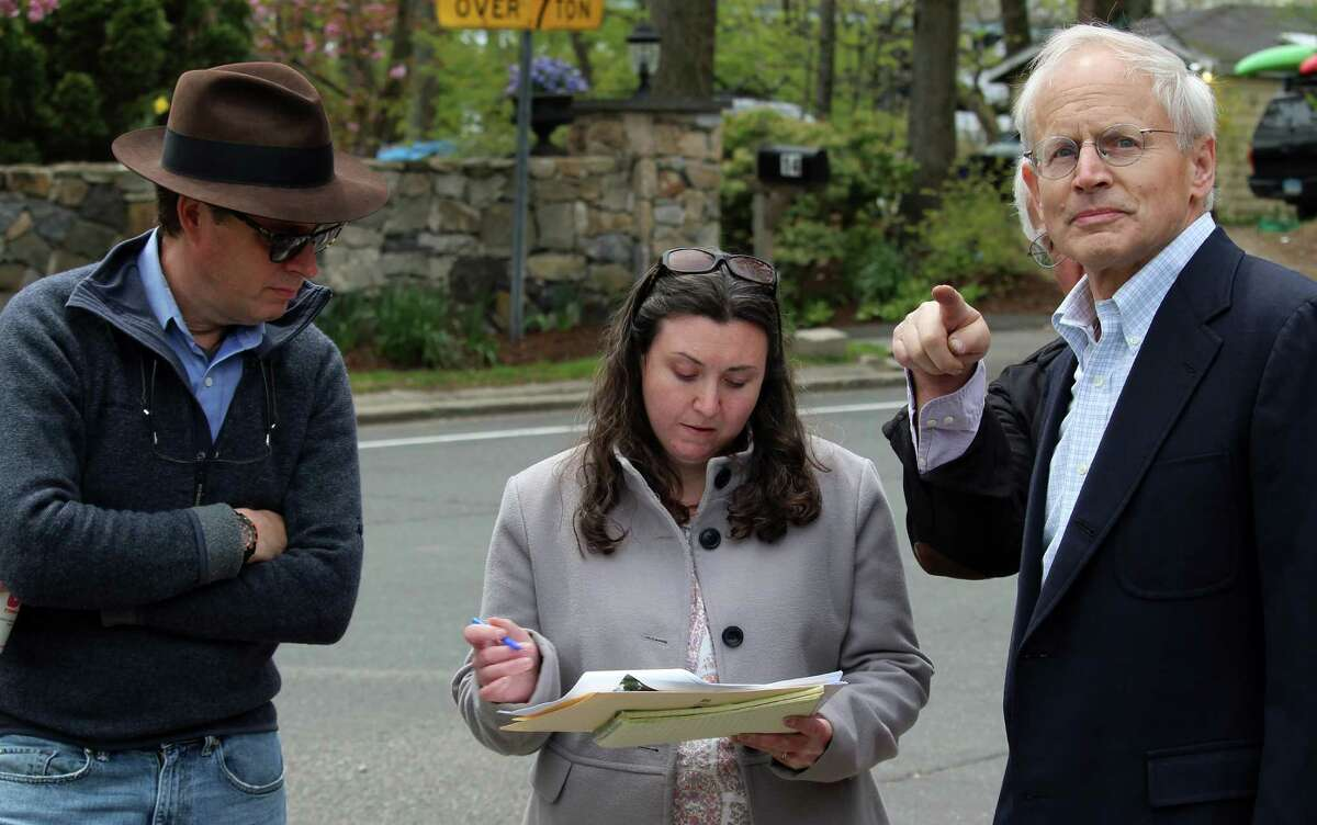 Morley Boyd, left, with Jenny Scofield, the National Register coordinator for the State Historic Preservation Office, and Historic District Commission Chairman Francis Henkels tour the Saugatuck neighborhood for its possible inclusion on the National Register of Historic Places.