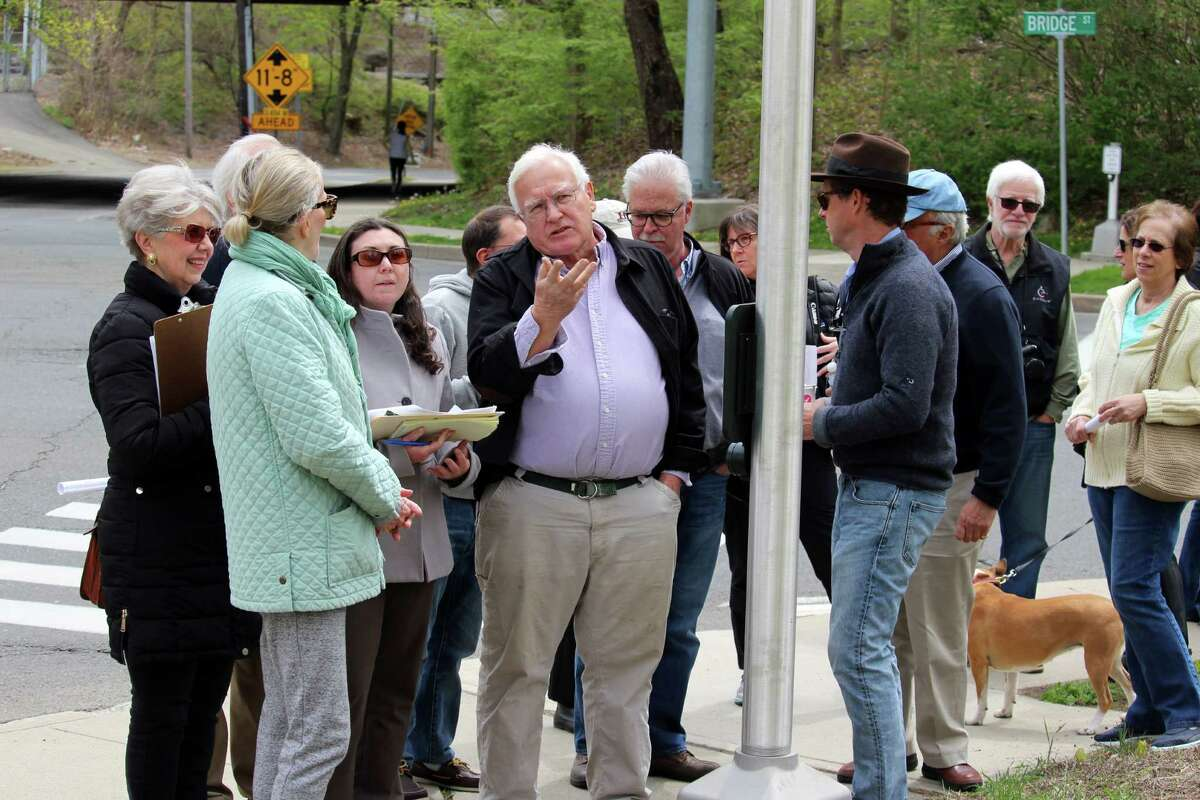 During a tour of the Saugatuck neighborhood, Werner Liepolt explains the historical significance of the area -- proposed for listing on the National Register of Historic places -- to Jenny Scofield, National Register coordinator for the State Historic Preservation Office.