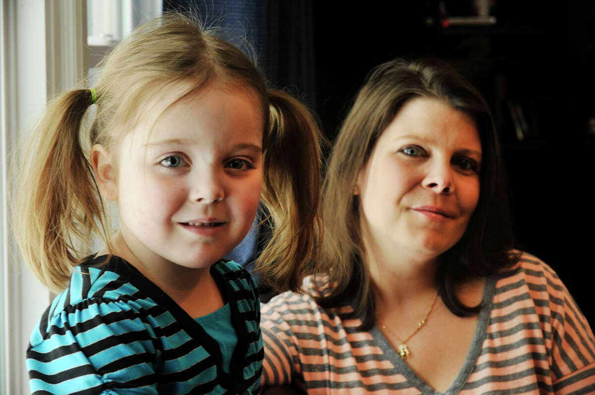 Then-five-year-old Ella Wright and her mother, Dana Haddox-Wright, in march of last year in their Wilton home. Ella has Dravet syndrome, a form of childhood epilepsy that has been found to respond to medicinal forms of cannabis.