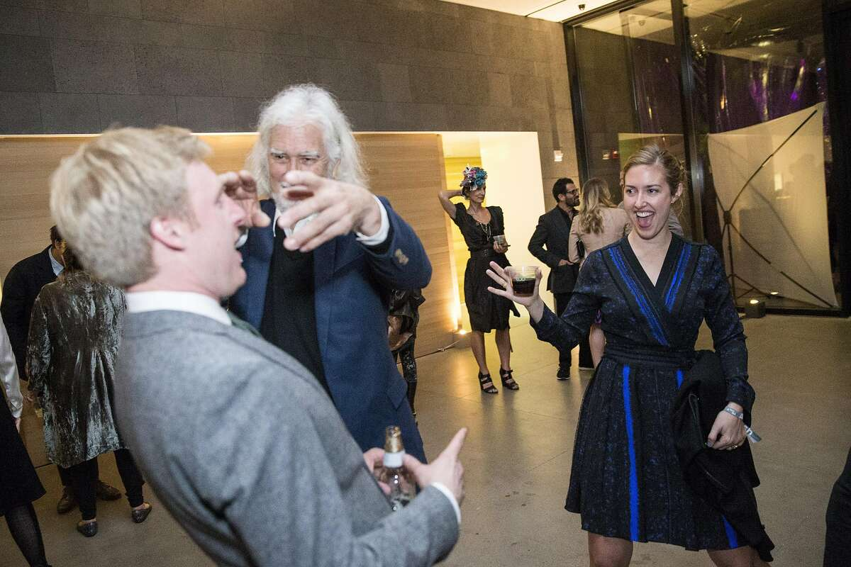 Emma Hanley (right) laughs as she watches her dad Jack Hanley (second from left) joke around on the dance floor during Art Bash, a party to celebrate the reopening of the San Francisco Museum of Modern Art after it's renovation and expansion, at the museum in San Francisco, Calif., on Friday, April 29, 2016. The museum opens to the general public on May 14.