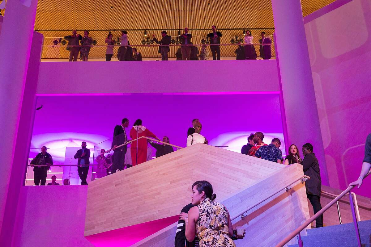 Guests of Art Bash, a party to celebrate the reopening of the San Francisco Museum of Modern Art, walk down the stairs of the renovated and expanded museum during the event in San Francisco, Calif., on Friday, April 29, 2016. The museum opens to the general public on May 14.