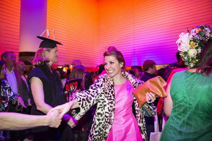Melanie Ross (center) enjoys the dance floor during Art Bash, a party to celebrate the reopening of the San Francisco Museum of Modern Art after it's renovation and expansion, at the museum in San Francisco, Calif., on Friday, April 29, 2016. The museum opens to the general public on May 14.