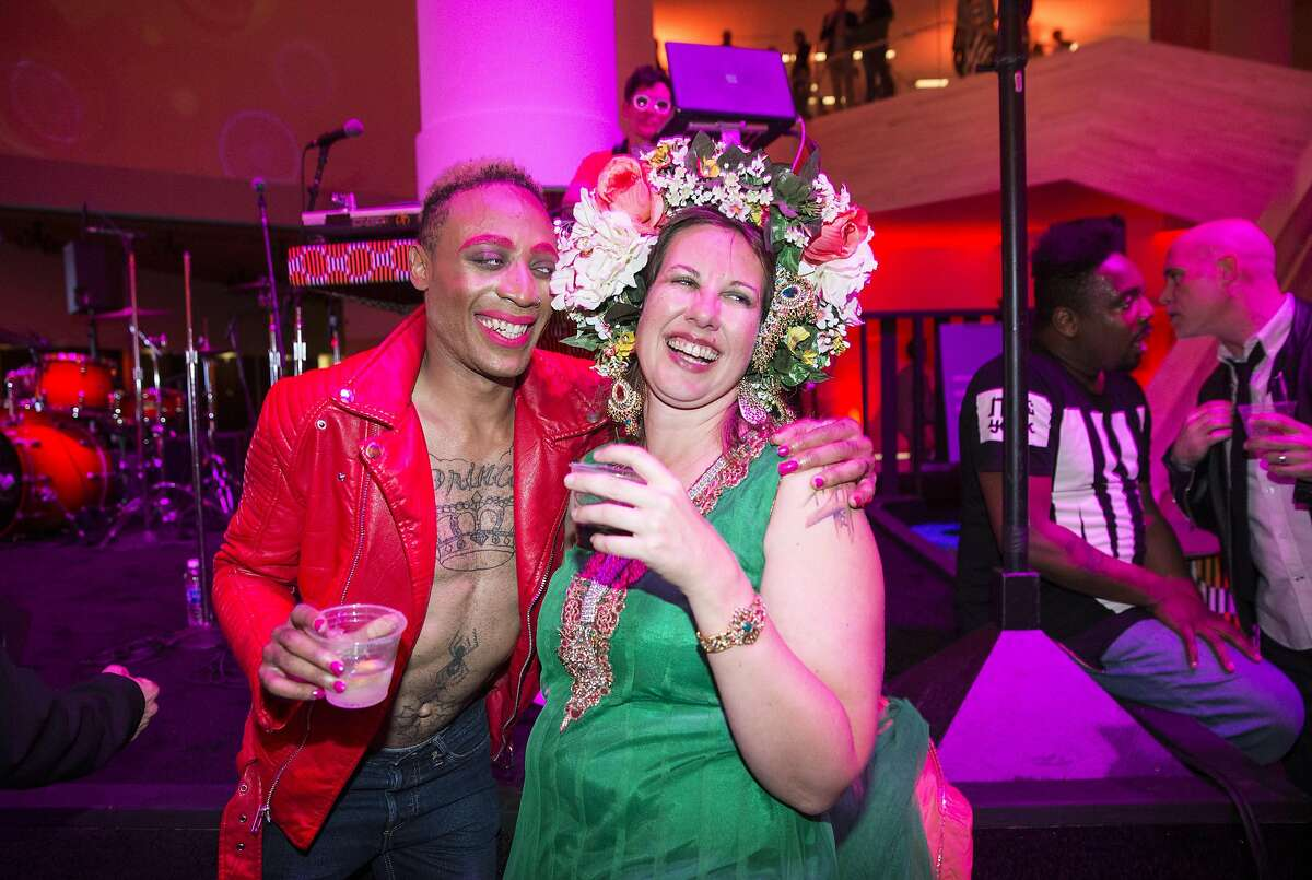 Tornado Revlon (left) and Meghan Arnold enjoy the dance floor during Art Bash, a party to celebrate the reopening of the San Francisco Museum of Modern Art after it's renovation and expansion, at the museum in San Francisco, Calif., on Friday, April 29, 2016. The museum opens to the general public on May 14.