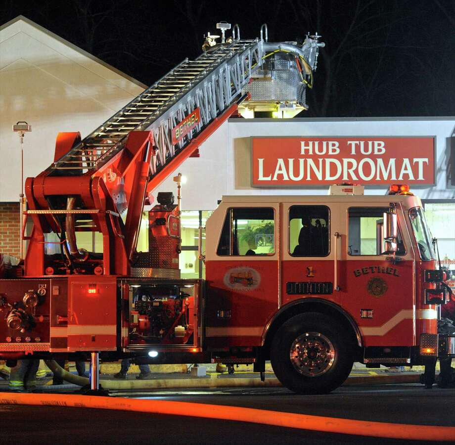 The Bethel Fire Department responded to a small fire at the Hub Tub Laundromat, in Bethel on Thursday night. According to the Bethel Fire Department the fire was contained in a commercial dryer and a vent, andwas under control in 10 minutes with no injuries or structural damage. Thursday night, January 7, 2015, in Bethel, Conn. Photo: H John Voorhees III / Hearst Connecticut Media / The News-Times