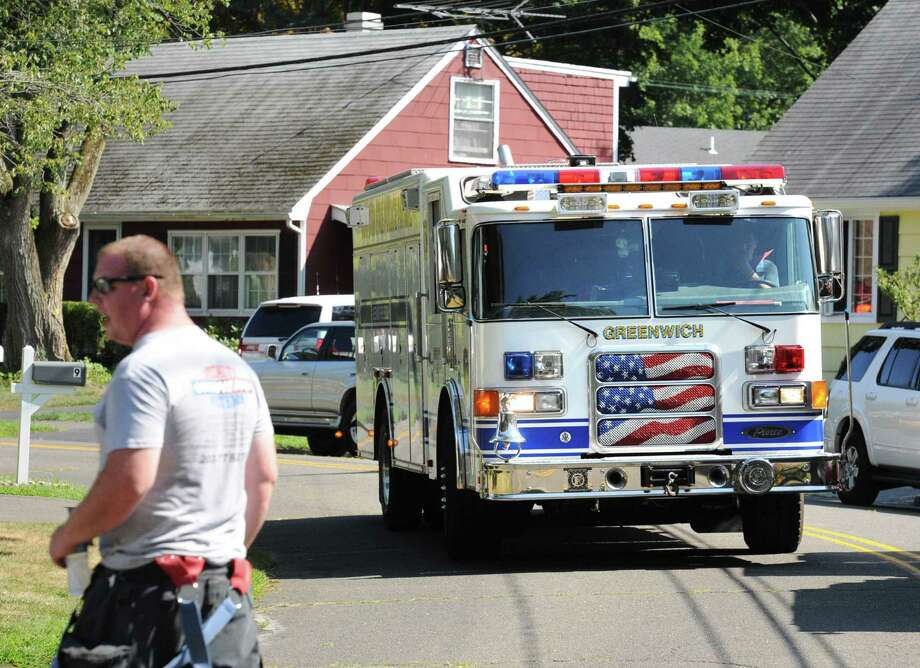Scene of the aftermath of a house fire at 14 Bonwit Rd. in the Riverside section of Greenwich, Conn., Tuesday afternoon, Aug. 26, 2014. According to Greenwich fire officials on the scene, the small fire inside the house was extinguished by the department quickly and there were no injuries. Photo: Bob Luckey / Bob Luckey / Greenwich Time