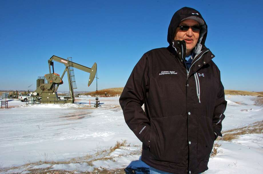 In this Feb. 25, 2015 photo, Clement Baker, a compliance officer for the Three Affiliated Tribes Environmental Division, is seen during an inspection of oil and gas production operations near Mandaree, N.D. A team led by researchers at the University of Michigan has found that fossil fuel production at the Bakken Formation in North Dakota and Montana is emitting roughly 2 percent of the ethane detected in the Earth's atmosphere. Along with its chemical cousin methane, ethane is a hydrocarbon that is a significant component of natural gas. Once in the atmosphere, ethane reacts with sunlight to form ozone.(AP Photo/Matthew Brown) Photo: Matthew Brown, Associated Press
