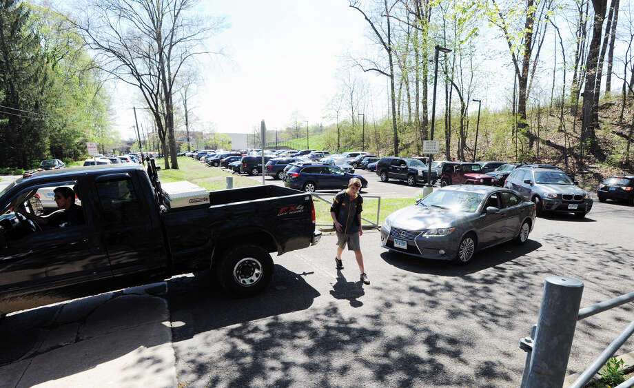 Vehicles in the north parking contend with a student at Greenwich High School, Greenwich, Conn., April 27, 2016. At left is Hillside Road. Photo: Bob Luckey Jr. / Hearst Connecticut Media / Greenwich Time
