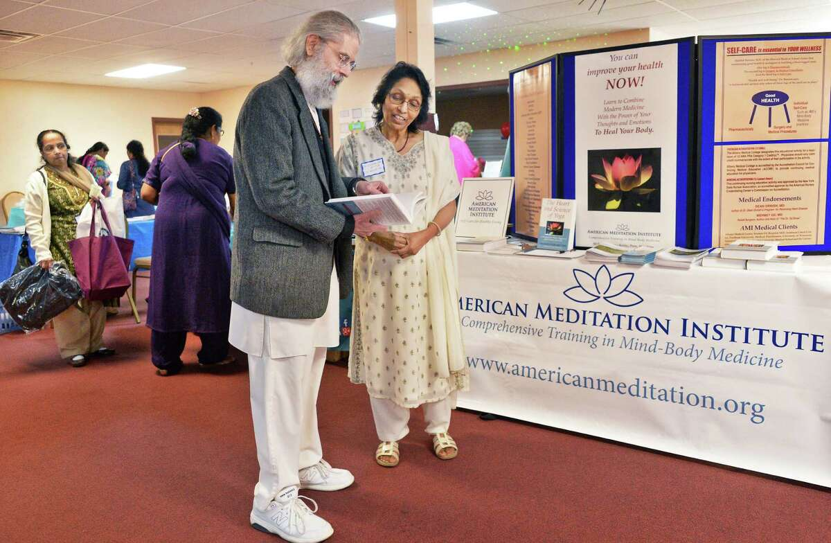 Leonard Perlmutter, founder and director of The American Meditation Institute and Dr. Swatantra Mitta, Hindu Cultural Center outreach coordinator, during the center's first health fair Saturday April 30, 2016 in Colonie, NY. (John Carl D'Annibale / Times Union)