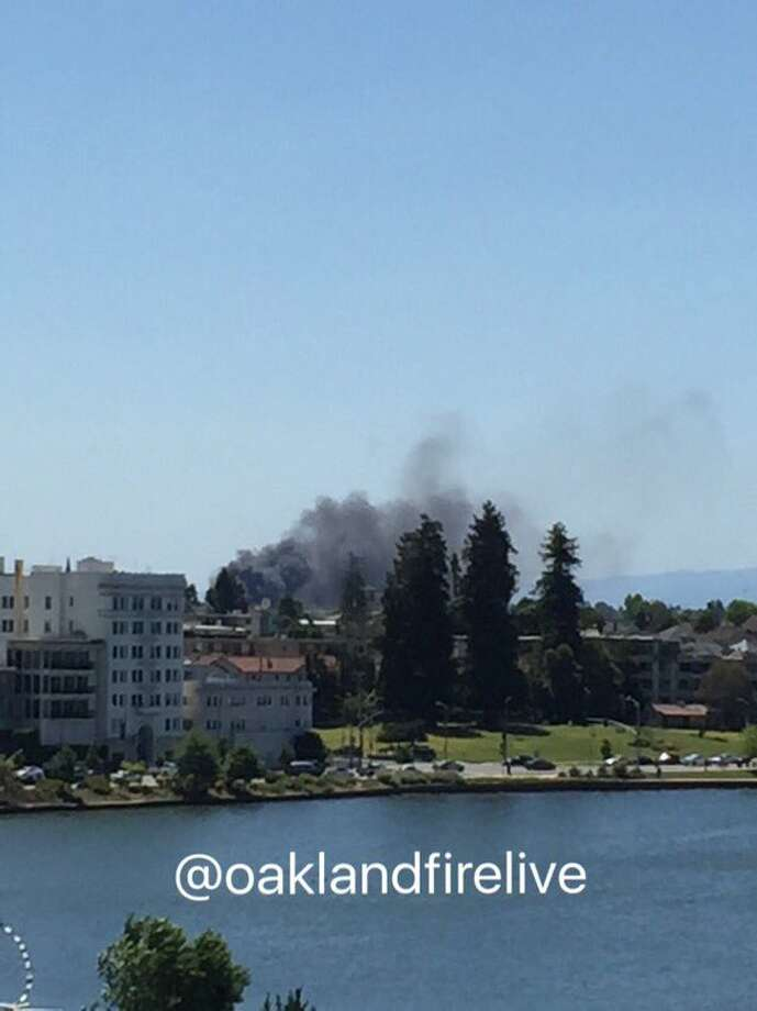 A fire burning on a pier in Oakland sent a large plume of smoke over the East Bay the afternoon of Saturday, April 30, 2016.