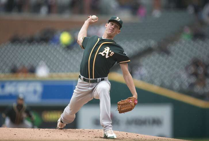 Oakland Athletics pitcher Chris Bassitt throws against the Detroit Tigers in the first inning of a baseball game in Detroit, Thursday, April 28, 2016. (AP Photo/Paul Sancya)