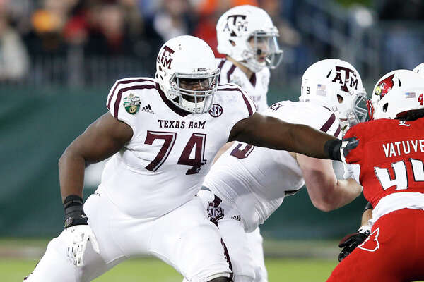 NASHVILLE, TN - DECEMBER 30: Germain Ifedi #74 of the Texas A&M Aggies in action against the Louisville Cardinals during the Franklin American Mortgage Music City Bowl at Nissan Stadium on December 30, 2015 in Nashville, Tennessee. Louisville defeated Texas A&M 27-21. (Photo by Joe Robbins/Getty Images)