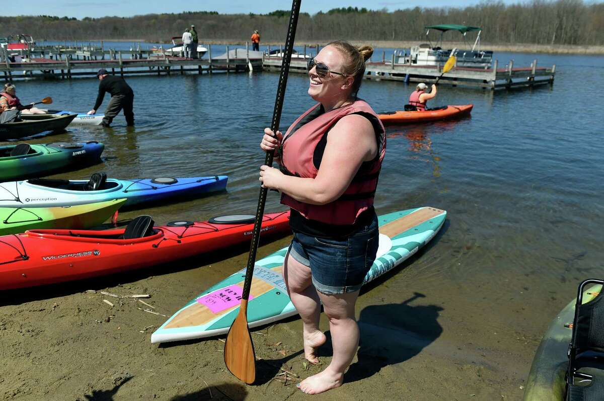 Rebecca Grugan, center, of Ballston Spa tries paddle boarding during the Saratoga Paddlefest and Outdoor Expo on Saturday, April 30, 2016, at Fish Creek Marina in Saratoga Springs, N.Y. The event, put on by Mountainman Outdoor Supply Company, featured free on-water demos, lessons and clinics. (Cindy Schultz / Times Union)