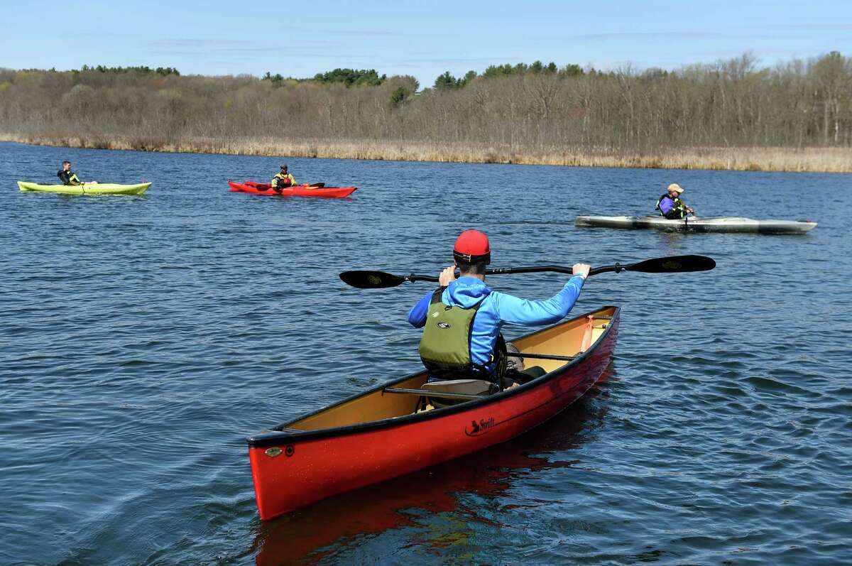Alexander Lamb, center, of Poughkeepsie takes out a Swift canoe during the Saratoga Paddlefest and Outdoor Expo on Saturday, April 30, 2016, at Fish Creek Marina in Saratoga Springs, N.Y. The event, put on by Mountainman Outdoor Supply Company, featured free on-water demos, lessons and clinics. (Cindy Schultz / Times Union)