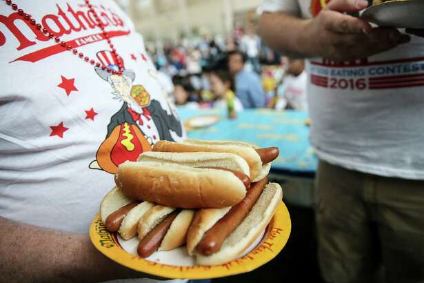 A few contestants took the extra hotdogs with them. Photos of NathanÕs Famous Hotdog Eating Contest at Memorial City Mall on Saturday, April 30, 2016, in Houston.