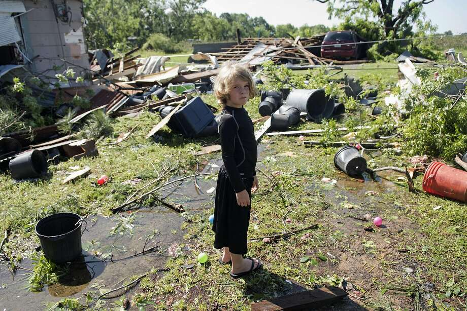 Memphis Melton, 7, looks at tornado damage in Lindale, Texas. Six died in flooding in Palestine. Photo: Sarah A. Miller, Associated Press