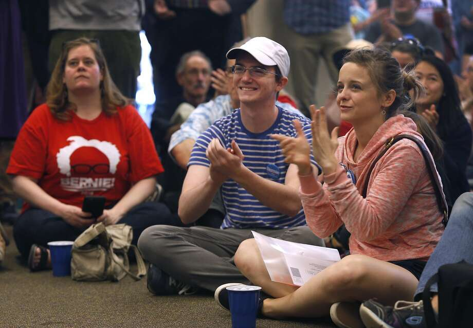 Cody England (center) and Lauren Ewald attend the opening of Bernie Sanders' Bay Area campaign headquarters. Photo: Paul Chinn, The Chronicle