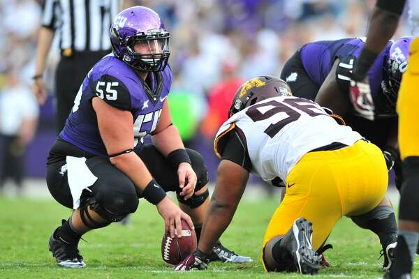 FORT WORTH, TX - SEPTEMBER 13:  Joey Hunt #55 of the TCU Horned Frogs lines up against the Minnesota Golden Gophers on September 13, 2014 at Amon G. Carter Stadium in Fort Worth, Texas.  (Photo by Cooper Neill/Getty Images)