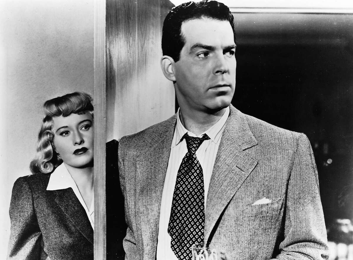 This undated publicity photo,provided by Universal Studios Home Entertainment, shows actors Fred MacMurray and Barbara Stanwyck in the 1944 noir film