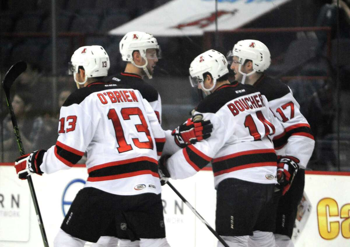 Devil Reid Boucher is congratulated by teammates after scoring a first period goal during their hockey game against Binghamton at the Times Union Center on Wednesday April 13, 2016 in Albany , N.Y. (Michael P. Farrell/Times Union)
