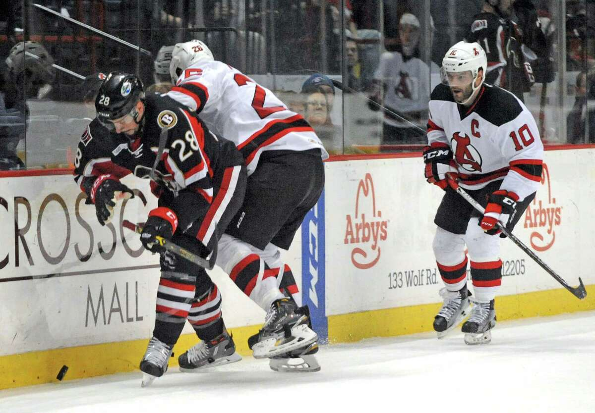 Devil Ben Thomson and Binghamton's Guillaume Lepine battle for the puck during their hockey game at the Times Union Center on Wednesday April 13, 2016 in Albany , N.Y. (Michael P. Farrell/Times Union)