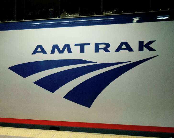 """FILE - In this Feb. 6, 2014 file photo, an Amtrak logo is seen on a train at 30th Street Station in Philadelphia. A federal appeals court has once again ruled that Congress can't give Amtrak power to impose rail standards on other private railroads. The U.S. Court of Appeals for the District of Columbia Circuit ruled Friday, April 29, 2016, it is unconstitutional to give a """"self-interested"""" company regulatory power over competitors , even if Amtrak is a public-private hybrid. (AP Photo/Matt Rourke, File)"""