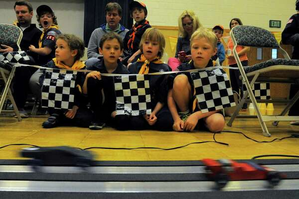 From left, Schuyler Morse, Baxter Colbath, John Morse and Noah Welte, all of Norwalk Pack 61, watch racers pass the finish line during the Powahay District's Pinewood Derby Championship in New Canaan on April 30, 2016.