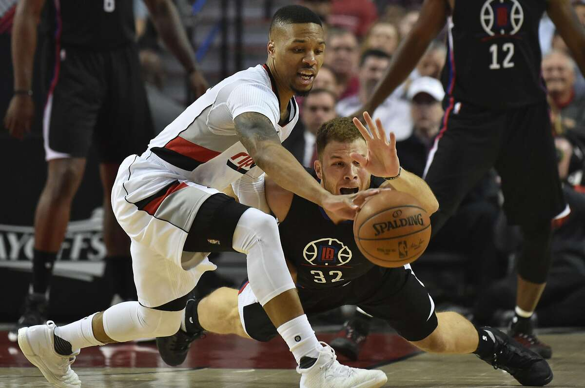 PORTLAND, OR - APRIL 25: Damian Lillard #0 of the Portland Trail Blazers and Blake Griffin #32 of the Los Angeles Clippers go after a loose ball in the first quarter of Game Four of the Western Conference Quarterfinals during the 2016 NBA Playoffs at the Moda Center on April 25, 2016 in Portland, Oregon. NOTE TO USER: User expressly acknowledges and agrees that by downloading and/or using this photograph, user is consenting to the terms and conditions of the Getty Images License Agreement. (Photo by Steve Dykes/Getty Images)