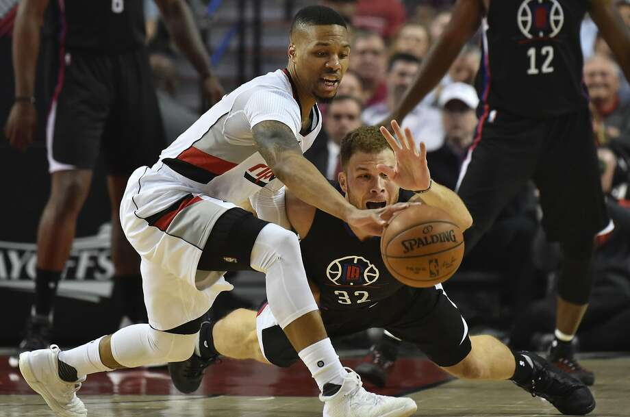 PORTLAND, OR - APRIL 25: Damian Lillard #0 of the Portland Trail Blazers and Blake Griffin #32 of the Los Angeles Clippers go after a loose ball in the first quarter of Game Four of the Western Conference Quarterfinals during the 2016 NBA Playoffs at the Moda Center on April 25, 2016 in Portland, Oregon. NOTE TO USER: User expressly acknowledges and agrees that by downloading and/or using this photograph, user is consenting to the terms and conditions of the Getty Images License Agreement. (Photo by Steve Dykes/Getty Images) Photo: Steve Dykes, Getty Images