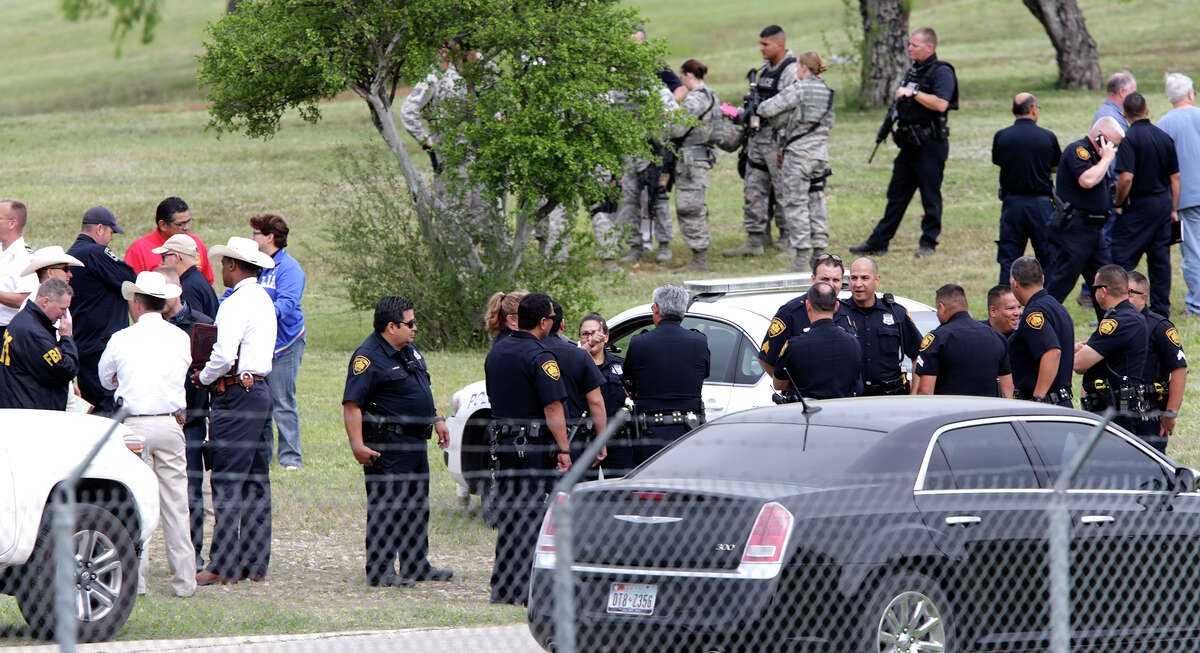 Emergency personnel respond to an active shooting at Joint Base San Antonio-Lackland's Medina Annex on Friday, April 8, 2016. Different law inforcement groups discuss the situation afte an all clear was given.