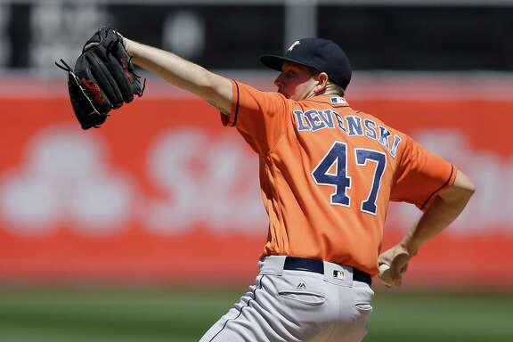Houston Astros pitcher Chris Devenski works against the Oakland Athletics in the first inning of a baseball game Saturday, April 30, 2016, in Oakland, Calif. (AP Photo/Ben Margot)
