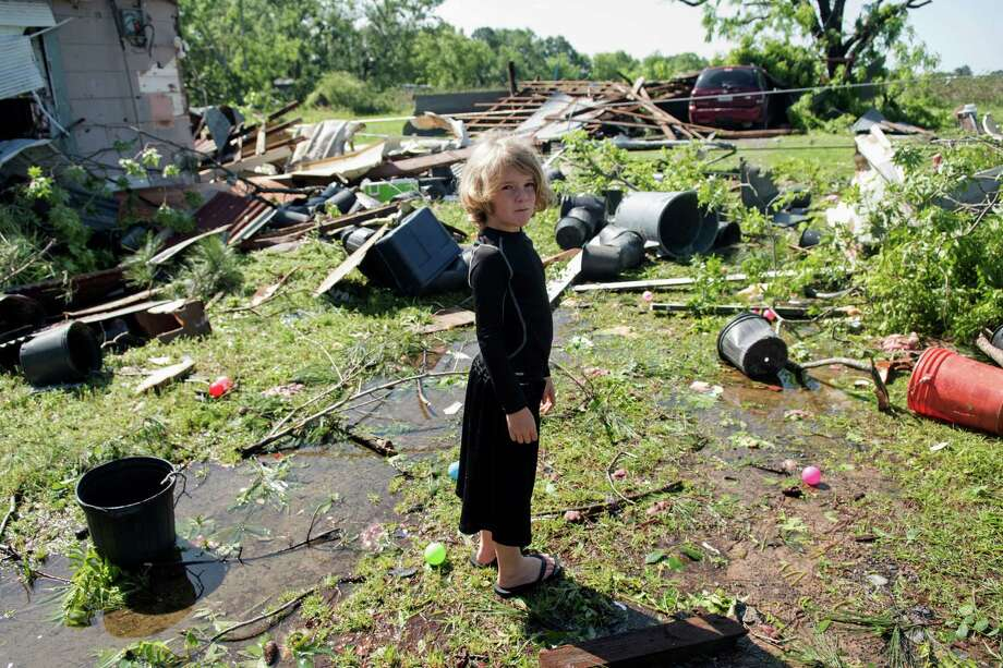 Memphis Melton, 7, looks at the destruction in his aunt's backyard in Lindale, Texas Saturday, April 30, 2016. A suspected tornado came through the area Friday night.  /Tyler Morning Telegraph via AP) MANDATORY CREDIT Photo: Sarah A. Miller, MBR / Tyler Morning Telegraph