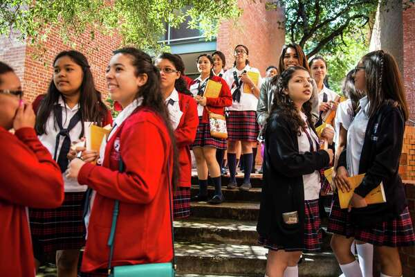 "Members of Young Women's Leadership Academy wait in line to get their books signed by Amy Cuddy, author of ""Presence: Bringing Your Boldest Self to Your Biggest Challenges,"" during Trinity University's first WomenÕs Leadership Summit in San Antonio, Texas on Saturday, April 30, 2016."