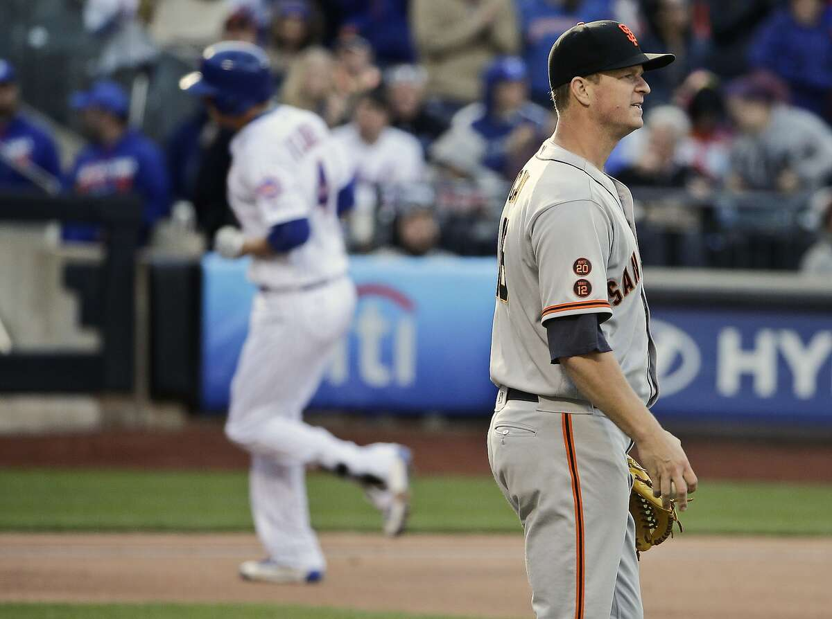 San Francisco Giants starting pitcher Matt Cain reacts as New York Mets' Wilmer Flores (4) runs the bases during the sixth inning of a baseball game Saturday, April 30, 2016, in New York. (AP Photo/Frank Franklin II)