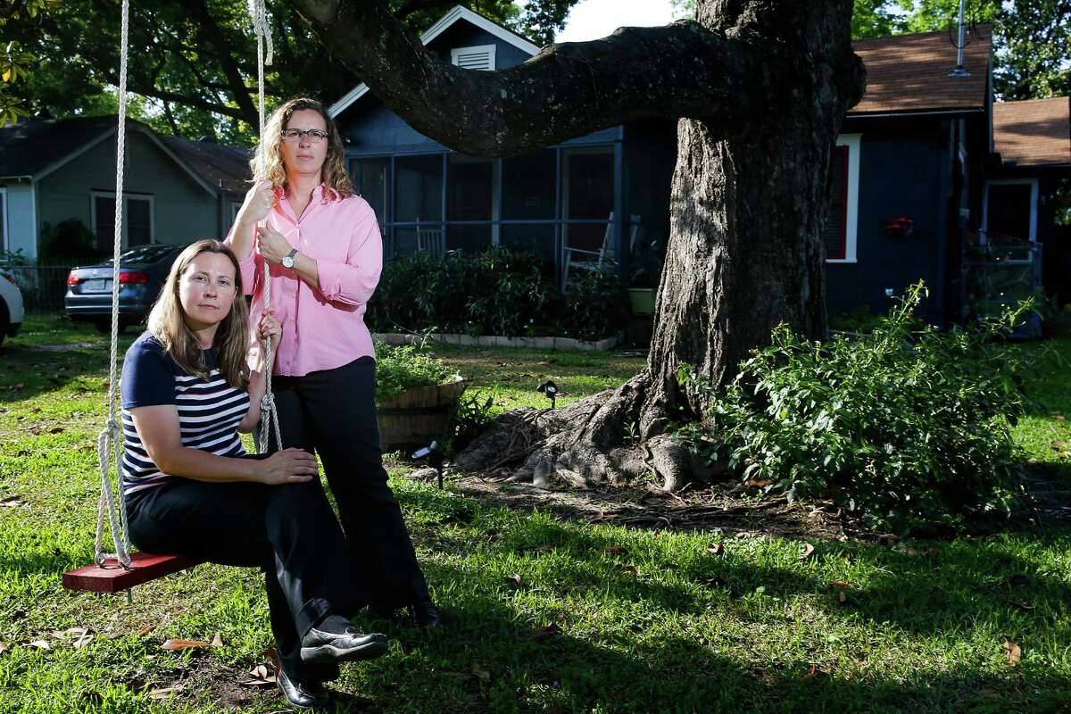 Foster parents Carol Jeffery, left, and Angela Sugarek sit on a swing they built for their two foster children. The couple is trying to regain custody of two brothers, ages three and four, taken away from them by Child Protective Services.