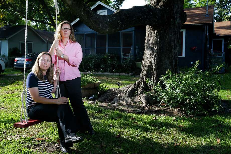 Foster parents Carol Jeffery, left, and Angela Sugarek sit on a swing they built for their two foster children. The couple is trying to regain custody of two brothers, ages three and four, taken away from them by Child Protective Services. Photo: Michael Ciaglo, Staff / © 2016  Houston Chronicle